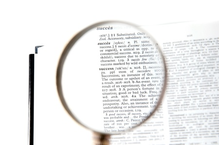A magnifying glass on the word success on a dictionary Stock Photo - 18656973