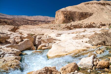 Water flows through the Western Jordan in Wadi Hasa Stock Photo