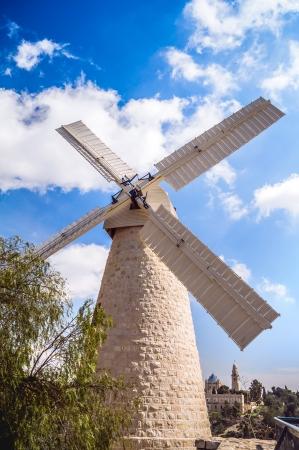 Montifiori windmill in Yemin Moshe, Jerusalem on background of blue sky