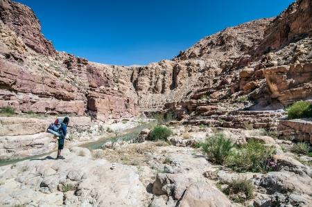 Hiker admiring the scenery in Jordan desert, Wadi Hasa