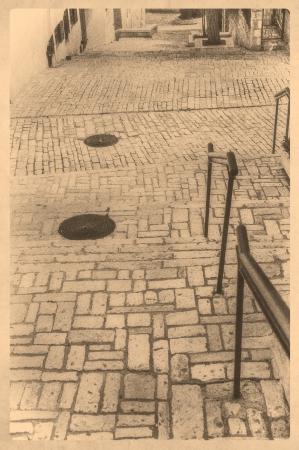 Fragment of the surface of a cobblestoned lane in Jerusalem, vintage effect
