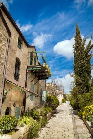Blue sky above the silent Jerusalem lane in Yemin Moshe