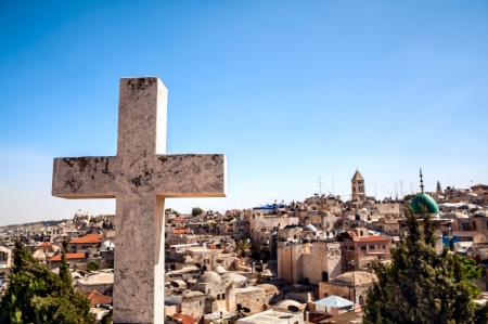 house of worship: The cross on the background of Jerusalem Old City Stock Photo
