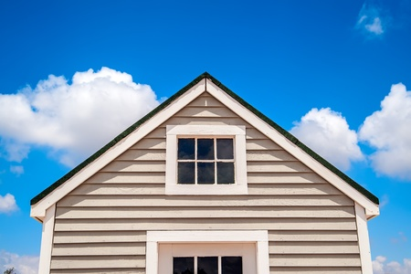 Fragment of the small wooden house, sky background photo
