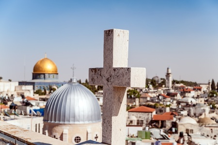 sepulchre: The cross on the background of Jerusalem Old City Stock Photo