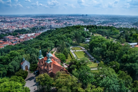 View on Prague cityscape and church in recreation park