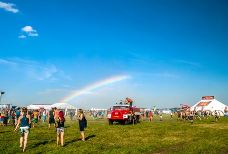 People enjoy the water from a fire truck on rainbow at Mighty Sounds festival 19th of July, 2013