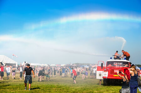 Water from a fire truck creates a rainbow at Mighty Sounds festival 19th of July, 2013 Editorial