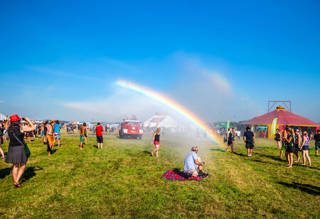 People watching at rainbow from a fire truck water at Mighty Sounds festival 19th of July, 2013