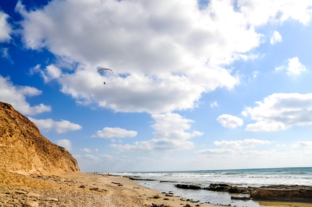 Flying paraglider over the sea on cloudy sky background, Israel Stock Photo