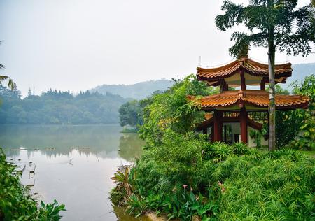 View on flamingo and pagoda on the lakeside Stock Photo