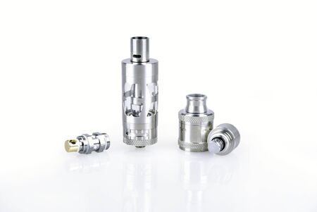 Atomizers and coils for e-cig mod on white background
