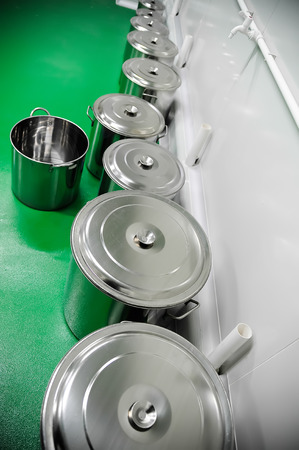 Row of industrial pans for mixology and preparations Stock Photo
