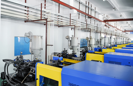 machines: View on plastic injection CNC machines at empty workshop Stock Photo