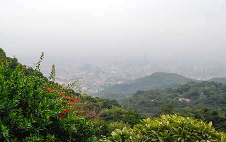 Urban landscape in mist from the top of hill