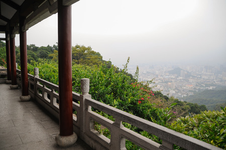 Terrace viewpoint on the mountain top, urban background Stock Photo