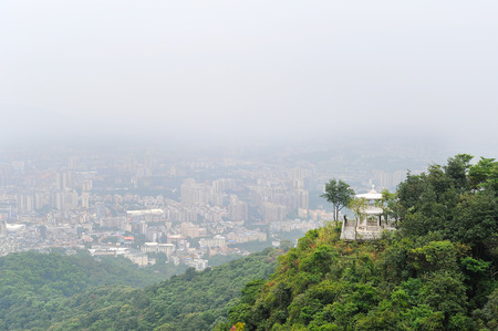 View on pagoda viewpoint from the mountain top on urban background
