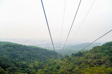 Cable car ropes on city background in Bayun mountain, Guangzhou, China Stock Photo