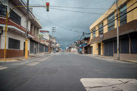 An empty street scene with focus on the side of a road