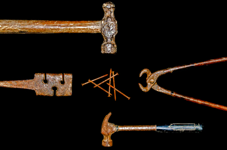 rusty nail: Craftsman tool and hammer, pliers, wrench, nail, rasp on the black background
