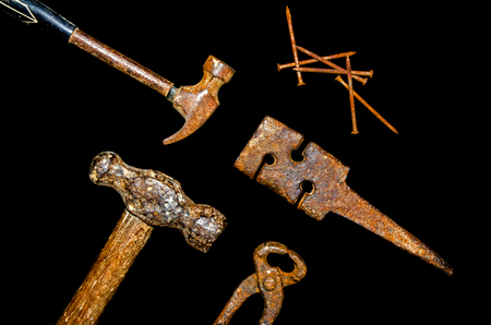 Set of craftsman tool and hammer, pliers, wrench, nail, rasp on the black background Stock Photo