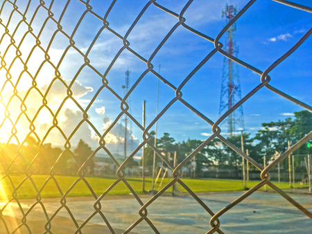 wired: Steel fence cages and Beautiful blue sky with sunset
