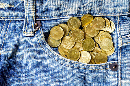 Texture of jeans lack and coin stack, jeans pattern background, jeans with credit card, visa card and master card and jeans lack on the black background for isolate