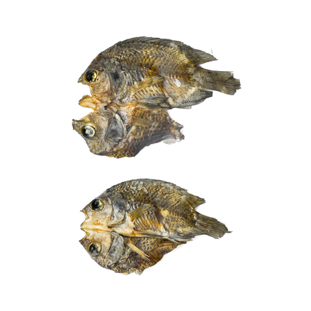 Dry fish and sunny on the white background, pattern of dried fish and small dried fish, top view of dry fish on the white background for isolate
