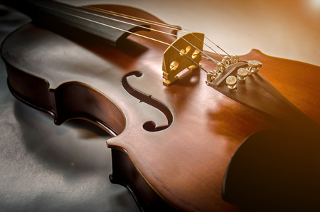 cellos: The violin on the table, Close up of violin on the wooden floor, Top view of violin musical on dark wooden floor