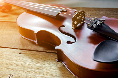baroque: The violin on the table, Close up of violin on the wooden floor, Top view of violin musical on dark wooden floor