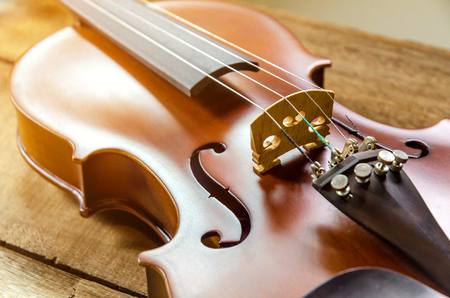 The violin on the table, Close up of violin on the wooden floor, Top view of violin musical on dark wooden floor