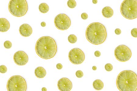 Close up of yellow lemon or lime on the white background, Fresh lemon slice and sour fruit or citrus fruit. 写真素材