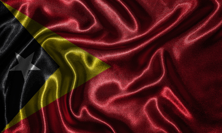 Timor Leste flag - Fabric flag of Timor Leste country, Background and wallpaper of waving flag by textile. Stock Photo