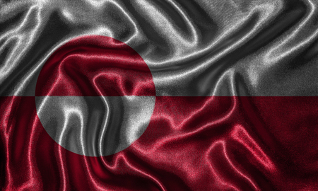 Greenland flag - Fabric flag of Greenland country, Background and wallpaper of waving flag by textile. 免版税图像