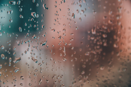 Wallpaper of rain drops or water drops on the glass, Vintage background by rainy drop on window, Rainy day with raindrop on the glass, Texture of water droplet on window glass.