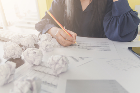 No idea and fail concept - Businesswoman sitting with crumpled paper or trash and paper ball or waste on the floor, Businessman are crumpling a paper of fail creativity concept or trash of idea.