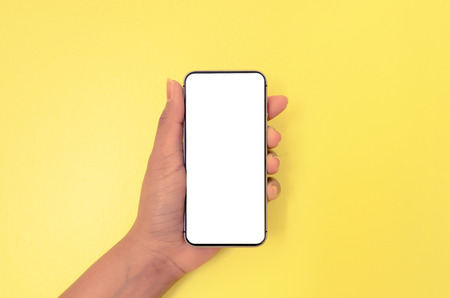 Human hand holding smartphone with white screen background, Mobile phone with white screen background for isolated, Concept of business, shopping and online by empty screen of mobile phone.