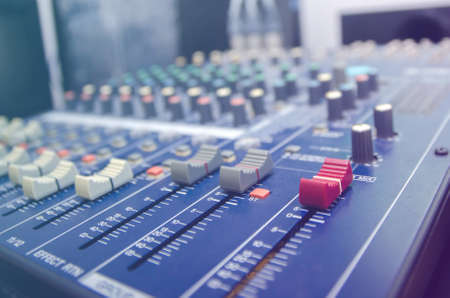 Audio mixer console and professional sound mixing. Audio mixer control panel with buttons and sliders. Mixer console for musician DJ and sound engineers.