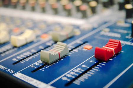 Audio mixer console and professional sound mixing. Audio mixer control panel with buttons and sliders. Mixer console for musician DJ and sound engineers. Imagens