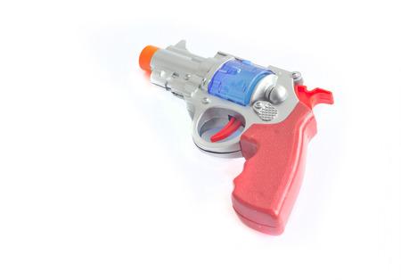 igniting: Handgun weapon toy on white background.