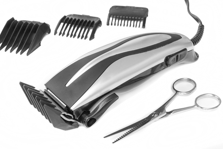 clippers: Beard and hair clippers and scissors on the white background. Stock Photo