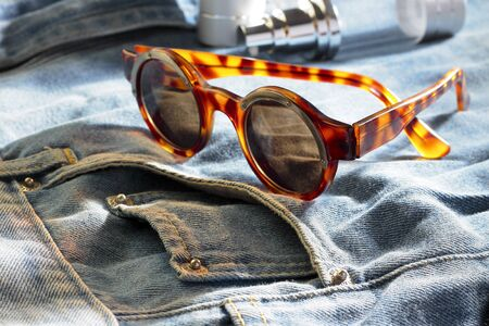 Jeans with sun glasses Stock Photo