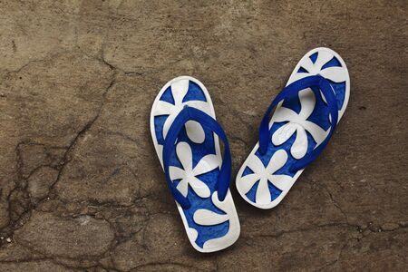 a pair of slipper on cement background Stock Photo