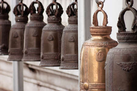 old brass church bells with thai temple