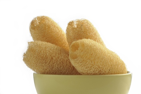 loofah sponges with cup on white background photo