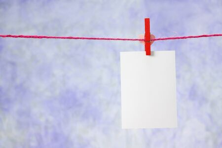 photo paper hanging on the clothesline on light blue background Stock Photo - 14511431