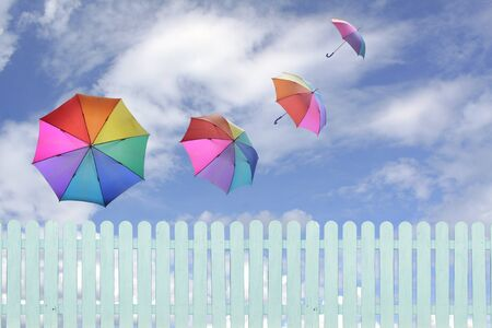 colorful umbrellas flying in a rich blue sky.conceptual image. photo
