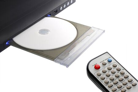 dvd player and remote control with disk open tray isolated on white background