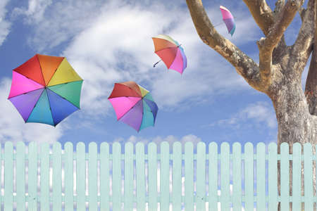 colorful umbrellas flying in a rich blue sky conceptual image Stock Photo - 16163468