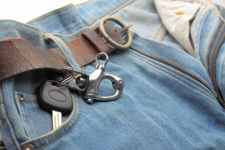 car key in pocket blue jeans photo